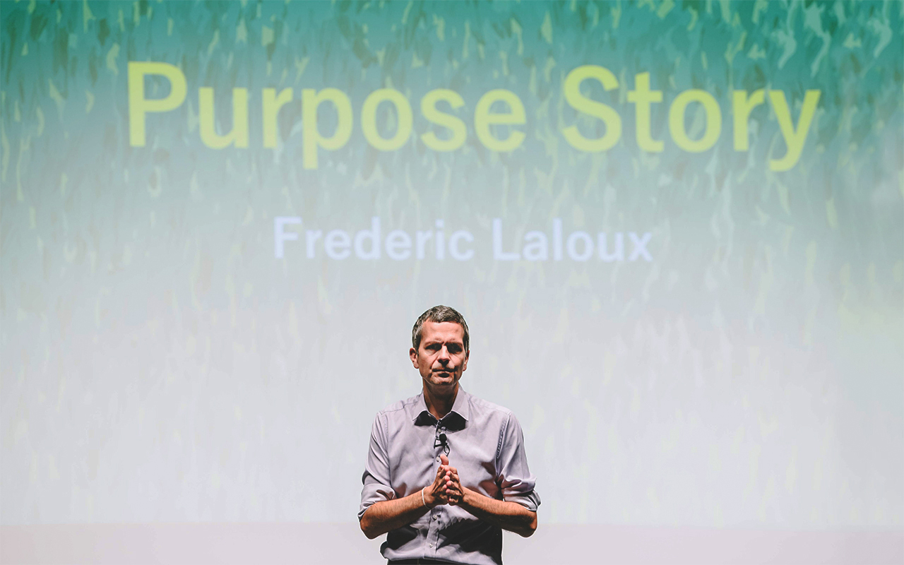 Frederic Laloux about to begin his talk about purpose.