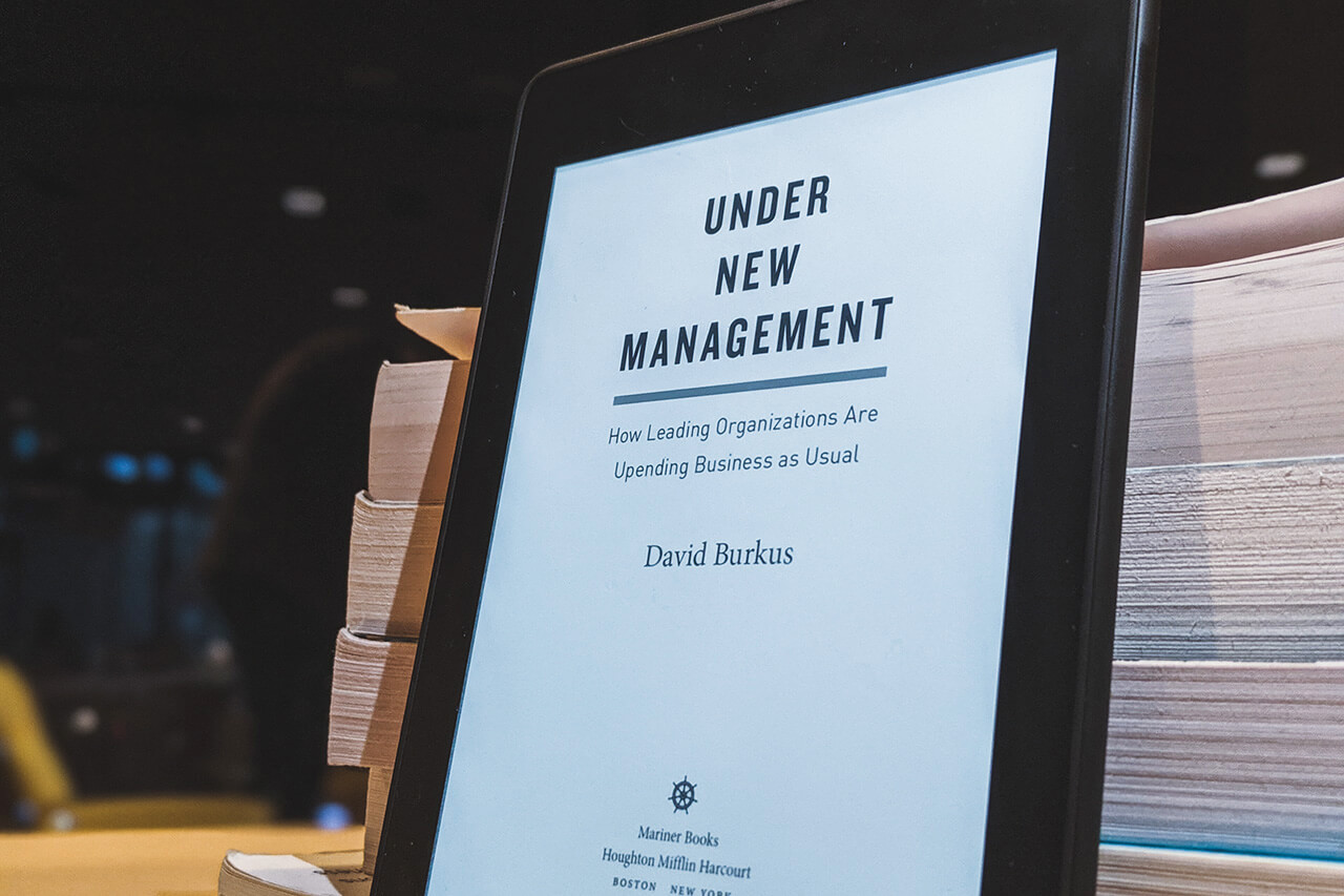 The e-book cover of David Burkus' book, Under New Management
