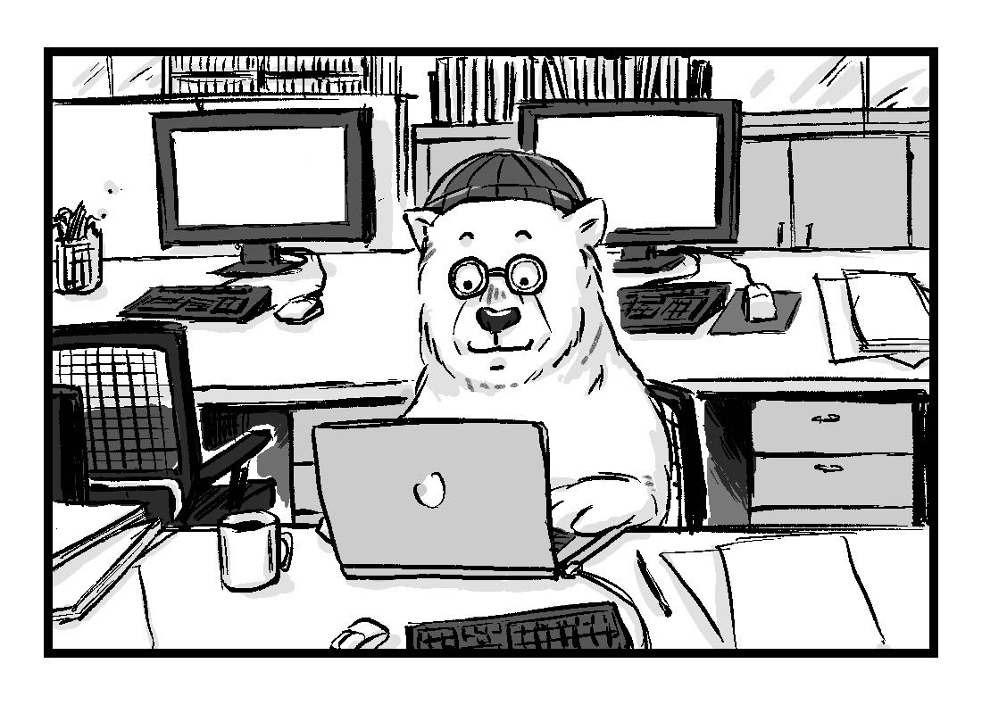 Alex the polar bear, working at a desk