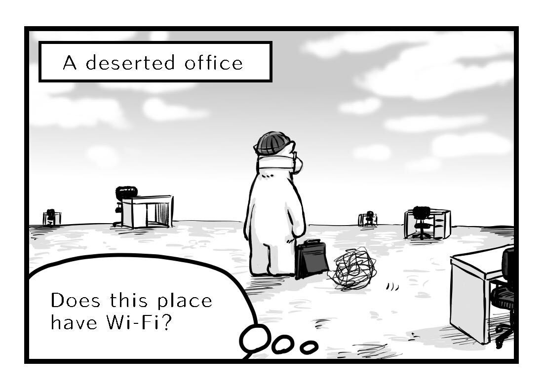 A deserted office with desks scattered around far away from each other